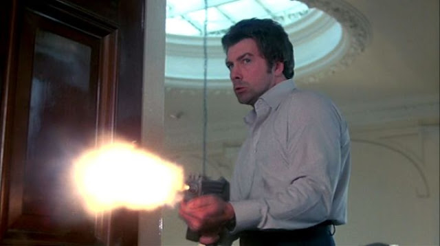 Lewis Collins firing a sub machine gun