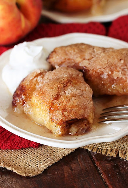 Baked Crescent Roll Peach Dumplings on Dessert Plate Image