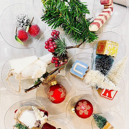 Recycled apple container filled with Christmas ornaments