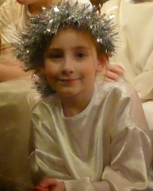 sasha as angel with tinsel