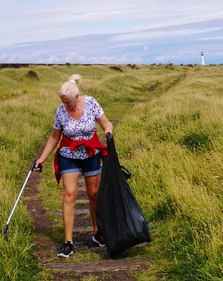 Photo of me collecting litter on Sunday