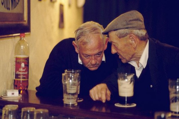 2 old men talking in a bar