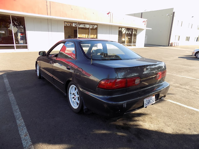 Integra with faded paint before complete car paint job at Almost Everything Auto Body.