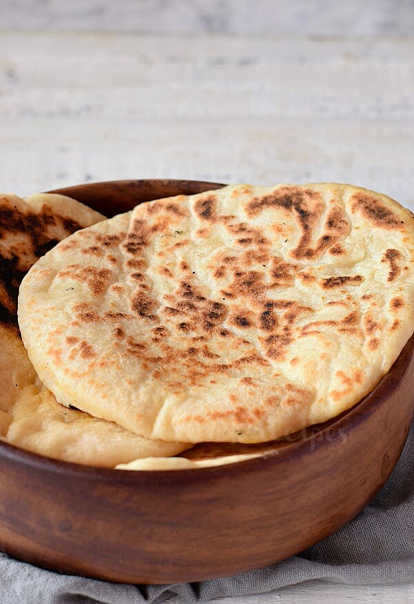 a wooden bowl with best pita bread