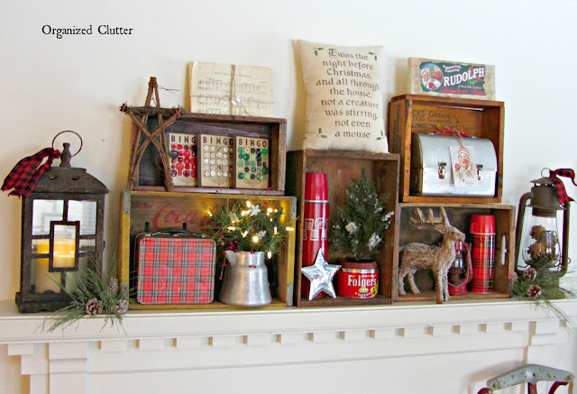 A rustic Christmas mantel with crate decor.
