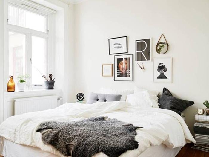 claves para decorar habitación de alquiler amueblada cama blanca con cuadros