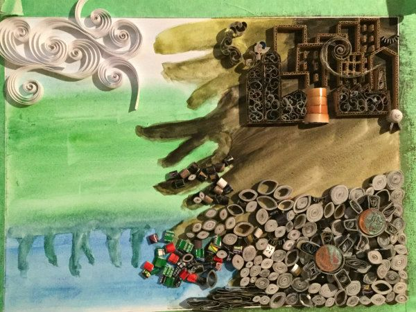quilled landscape in progress showing watercolor background of water, land, and sky with quilled coils