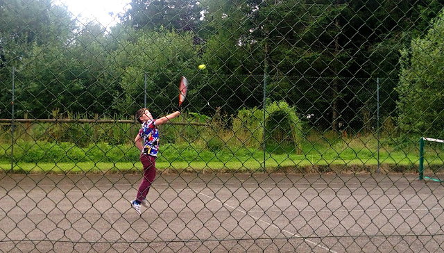 Boy playing tennis at Forest Glade