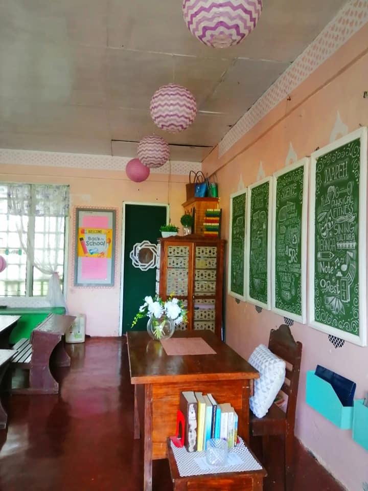 Teacher makes creative bulletin boards using chalk