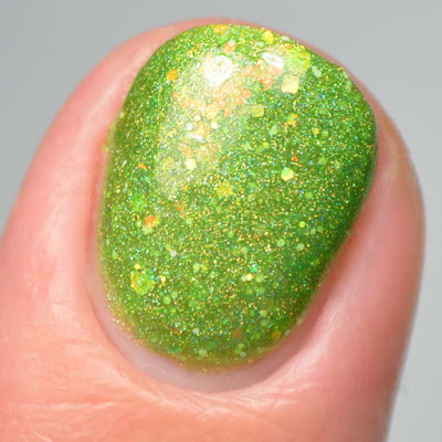 green nail polish with iridescent glitter close up swatch