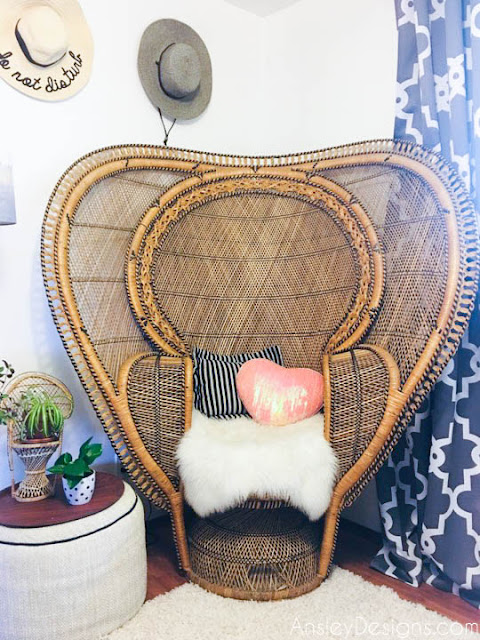 Boho vintage wicker peacock cobra chair with sheepskin rug bohemian