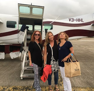 Jacklyn Zeman posing for photo with her friends while private jet in the background
