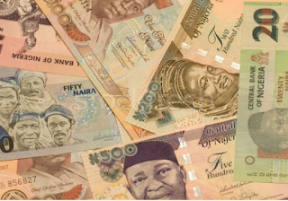 Naira devaluation boosts loan growth for tier one lenders