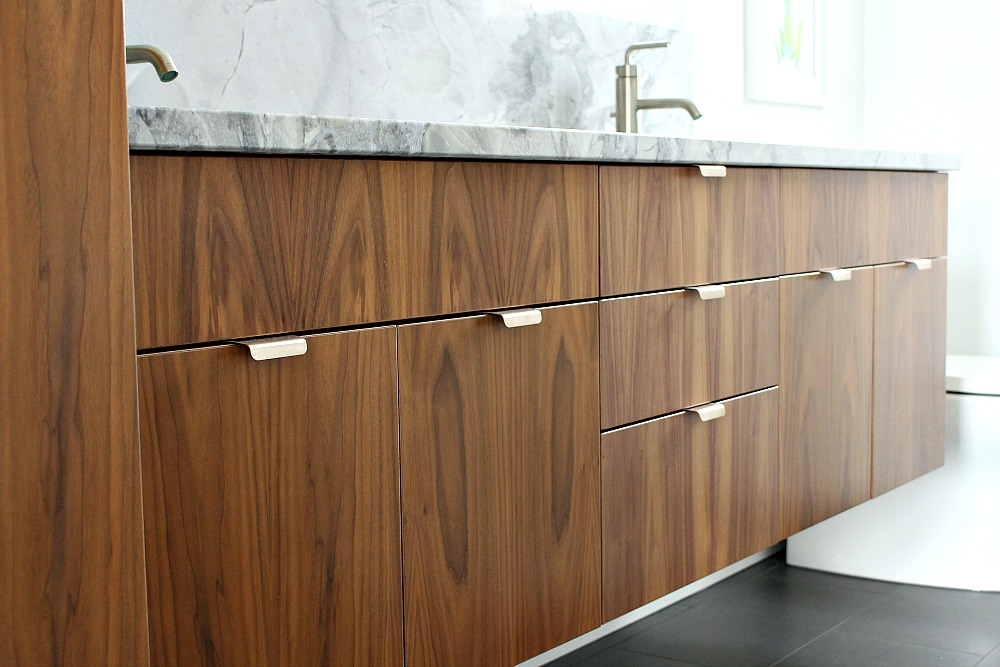 Bathroom Vanities Knobs Or Pulls bathroom reno update: mid-century modern inspired cabinet pulls