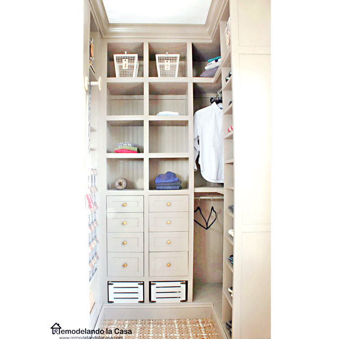 a small closet is transformed with lots of storage space