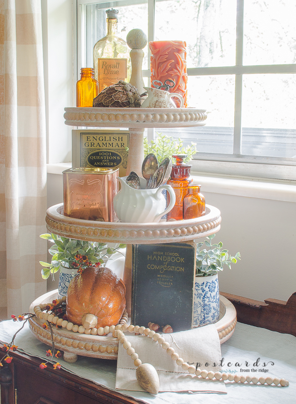 wood tiered tray with amber bottles, various fall decor