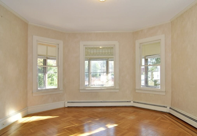 white painted craftsman woodwork in living room of Sears Avoca in Cranston RI