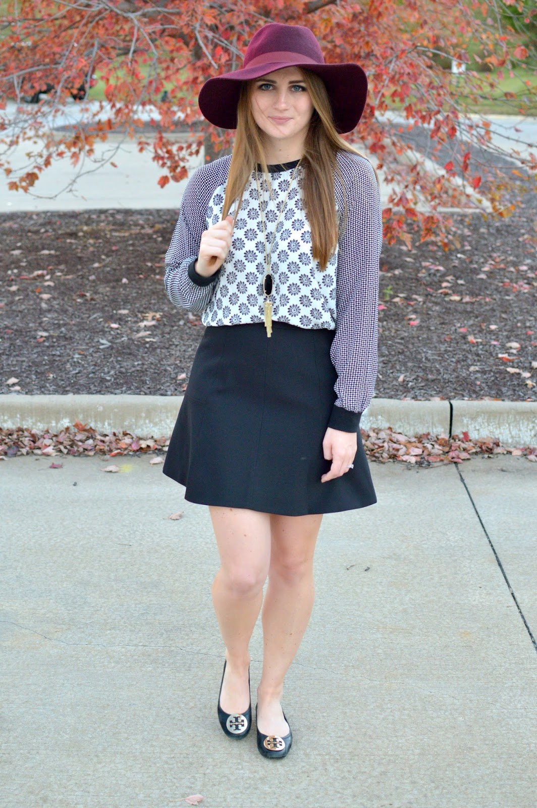 printed black and white top with a black skirt