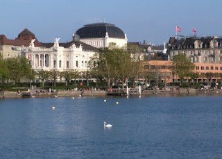 Lake view of the Opera House with swans, Zürich, Switzerland
