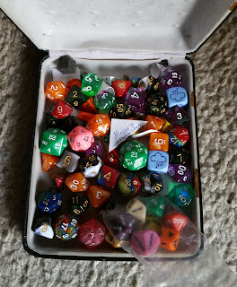 A container of mixed dice