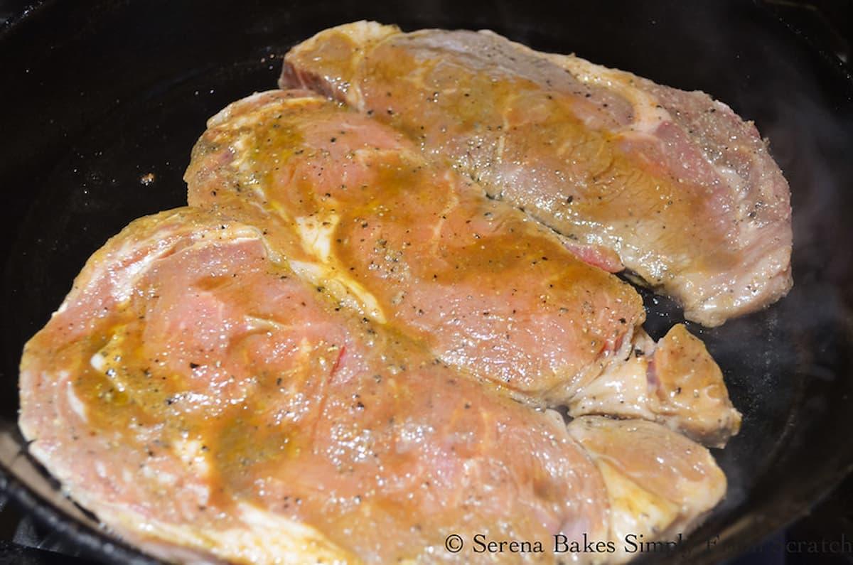 3 Boneless Rib Eye Steaks in a cast iron pan.