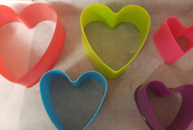 Setting out heart shaped cookie cutters for bird feeders