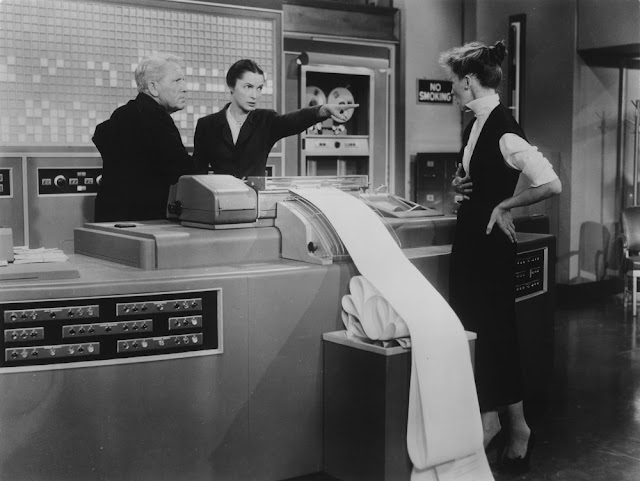 Black and white still photograph from the 1957 film, 'Desk Set'