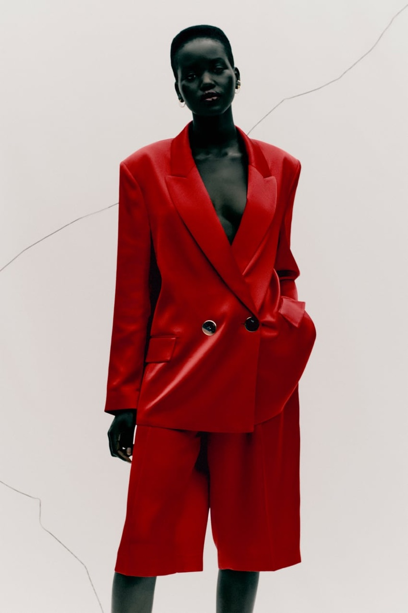 Adut Akech models Zara satin effect blazer and pleated satin effect shorts.