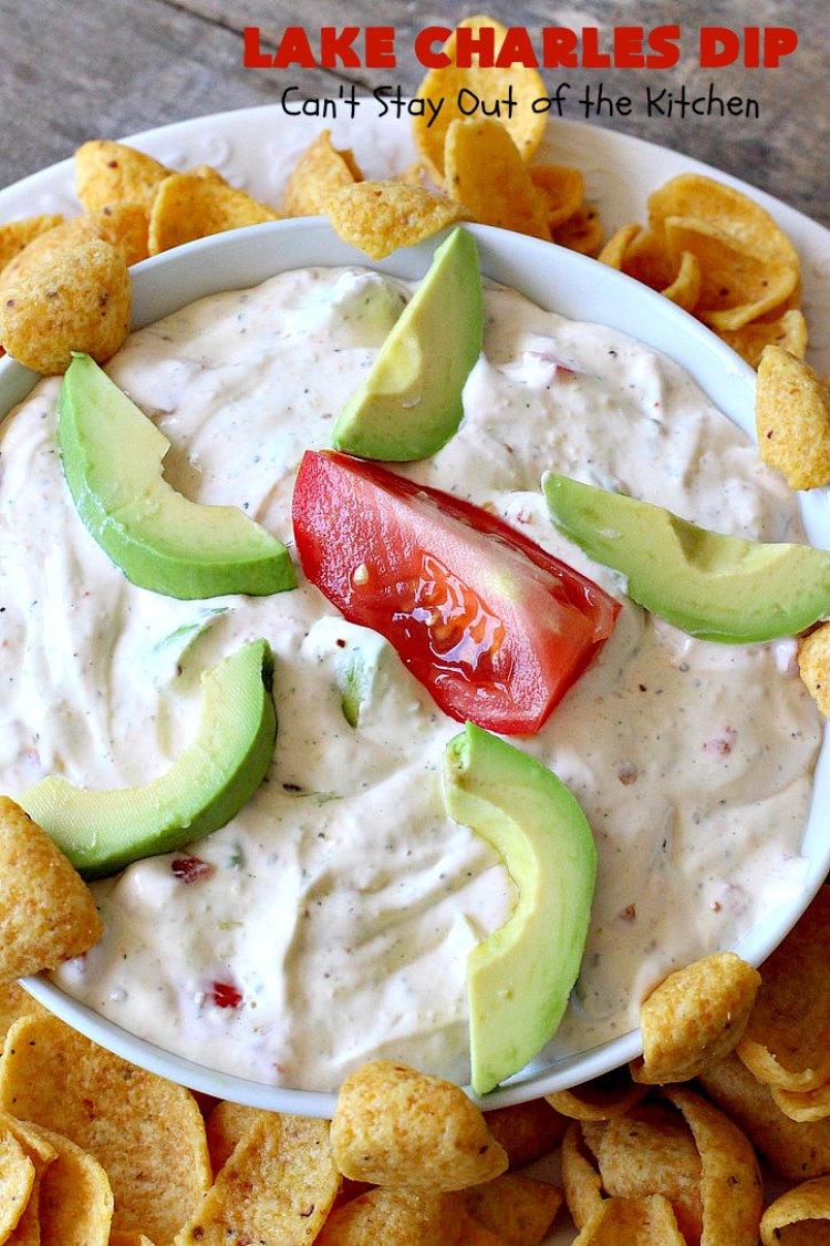 Lake Charles Dip is a delicious cajun appetizer that includes avocados, tomatoes, hot sauce & Good Seasons Italian seasoning mix. It's perfect for tailgating or office parties, potlucks or backyard barbecues.