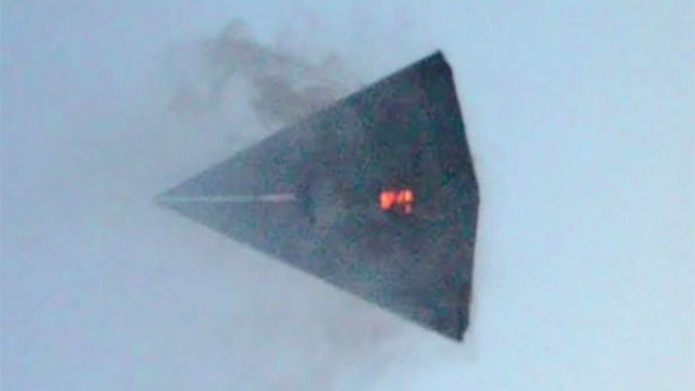Triangle UFO Caught On fire with smoke coming out of it over Area 51.