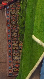 Oriental rug or capet in Jan van Eyck's Arnolfini Portrait, symbolizes whealth and opulence