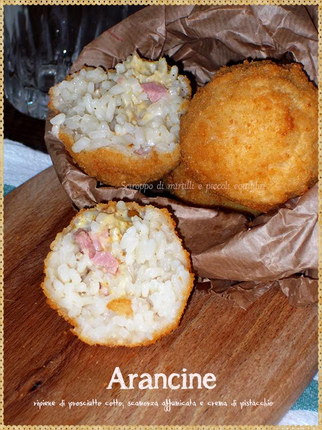 Arancine  ripiene di prosciutto cotto, scamorza affumicata e crema di pistacchio