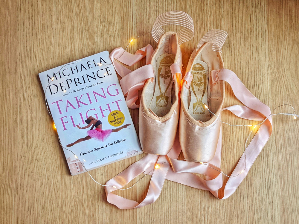 Memoir Taking Flight by Michaela DePrince, fairy lights, and pointe shoes.