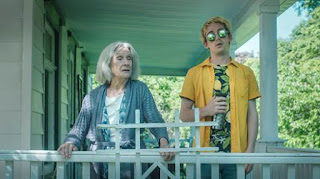 Thomas Duplessie and Cloris Leachman standing on a house porch