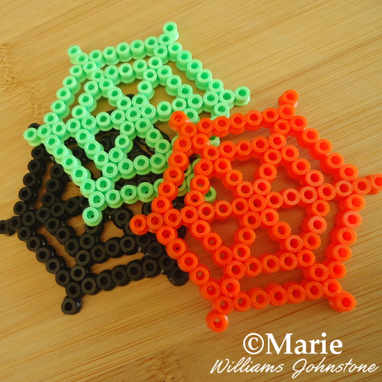 Completed Spiderweb Perler Bead Designs in Halloween Colors Green Black Orange Spiders Craft Spider Webs Cobwebs