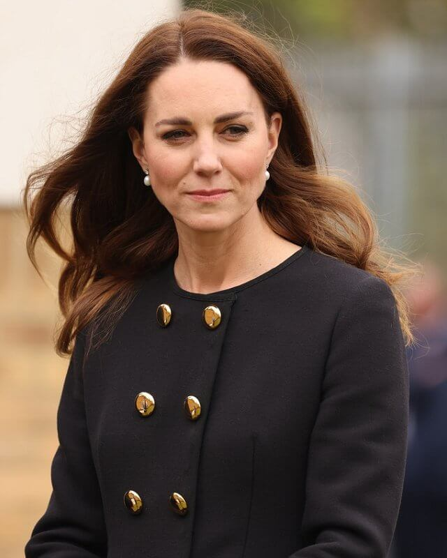 Kate Middleton wore a collarless long coat from Dolce & Gabbana, and suede pumps from Tod's. She carried Mulberry Bayswater clutch