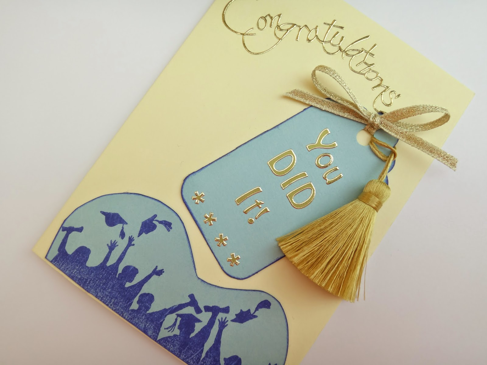 Hand made graduation card with hat toss stamp and tassel