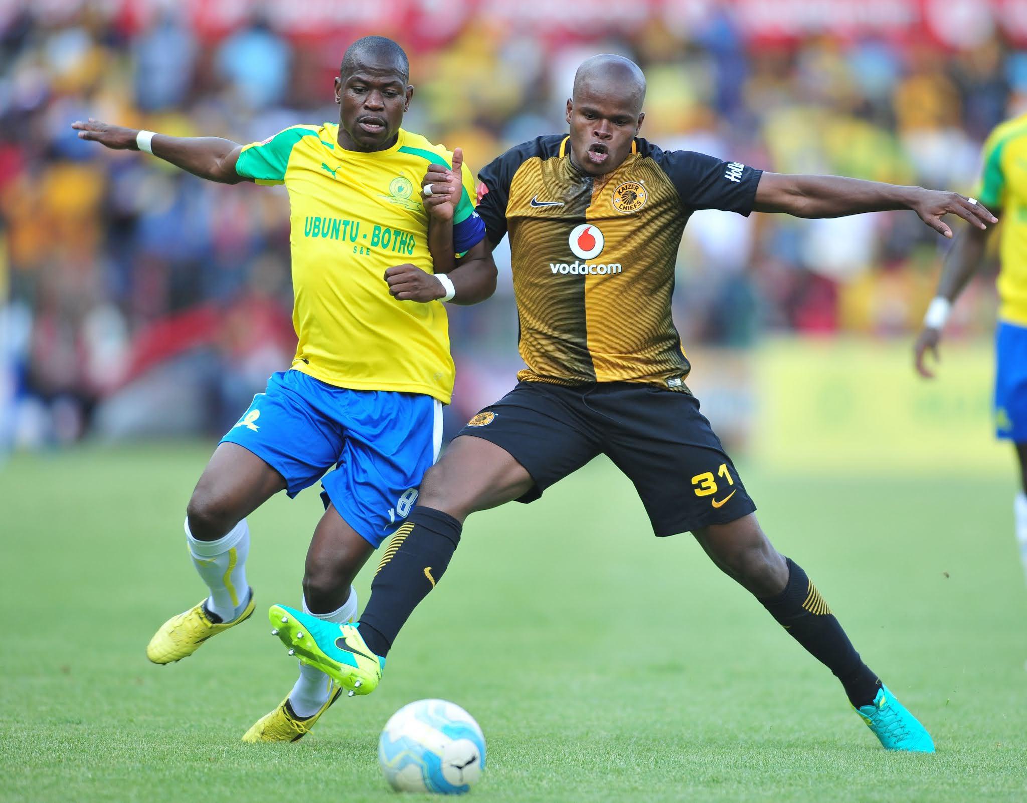 Willard Katsande jostling for position against Sundowns captain Hlompo Kekana