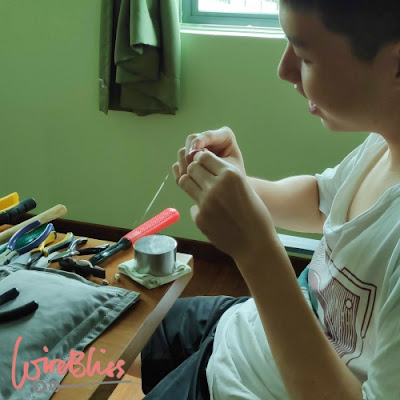 William working on his wire wrapped earring