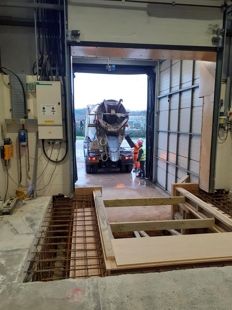 Getting the concrete mixer ready at Garador