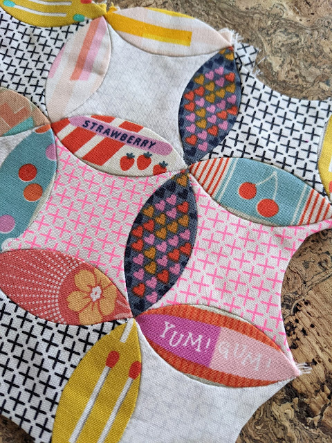 curved English paper pieced shapes, modern fabrics epp leaves and points