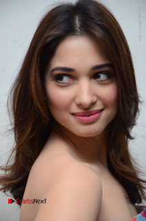 Actress Tamanna Latest Images in Floral Short Dress at Okkadochadu Movie Promotions  0127.JPG