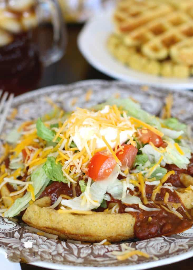 Cornbread Waffles with Chili and Fixins' - Cornbread waffles with chili and fixings is one of our favorite weeknight meals. Easy to make and the two flavors were meant to go together!