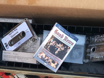 """""""Good News"""" music cassette in a box full of music cassettes"""
