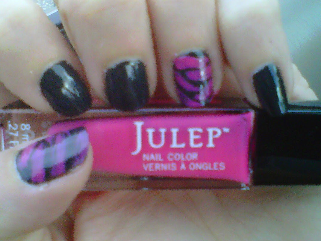 Fingernail art: Charcoal Grey with pink tiger stripes on the thumb and ring finger.