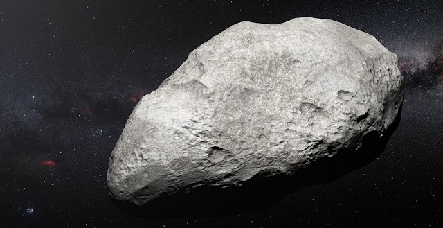 This artist's impression shows the exiled asteroid 2004 EW95, the first carbon-rich asteroid confirmed to exist in the Kuiper Belt and a relic of the primordial Solar System. This curious object likely formed in the asteroid belt between Mars and Jupiter and must have been transported billions of kilometres from its origin to its current home in the Kuiper Belt.  Credit: ESO/M. Kornmesser