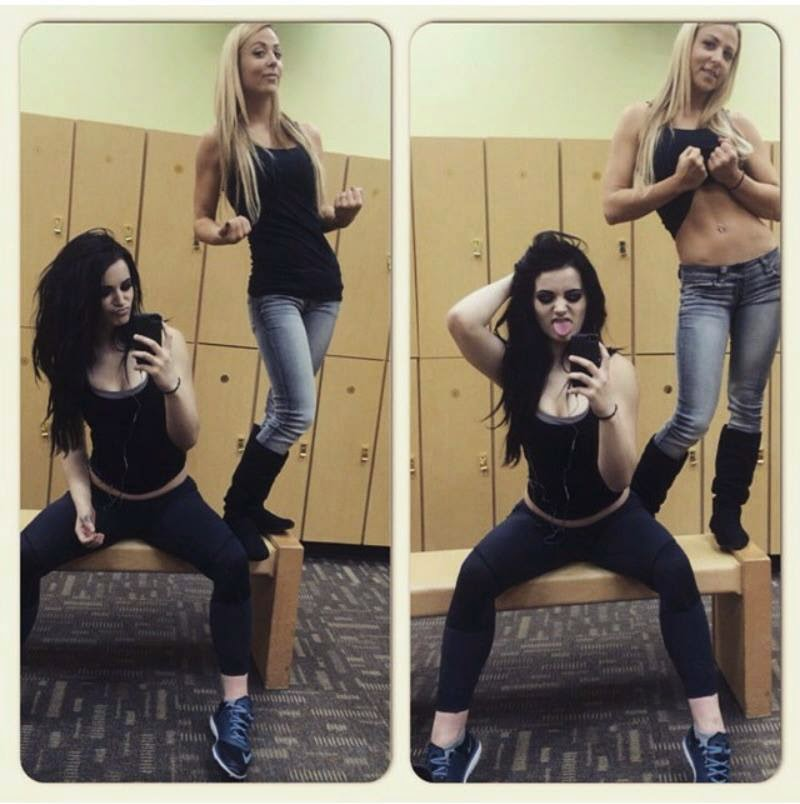 Wwe emma and paige at a miley cyrus concert