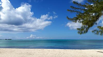 Empty beach, sun, sand and sea.