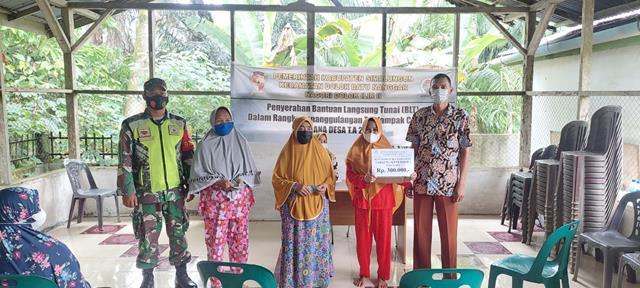 Dalam Rangka Penyerahan Dana Desa Kepada Masyarakat Didampingi Personel Jajaran Kodim 0207/Simalungun