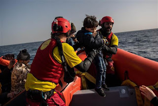 Spanish rescuers saving  migrants